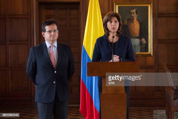 Colombian Foreign Minister Maria Angela Holguin and Colombia's ambassador to Venezuela Ricardo Lozano talk during a press conference in Bogota on...
