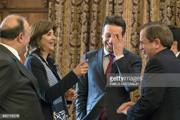 Colombian Foreign Minister Maria Angela Holguin and her Ecuadorean counterpart Guillaume Long share a laugh after a press conference in the framework...