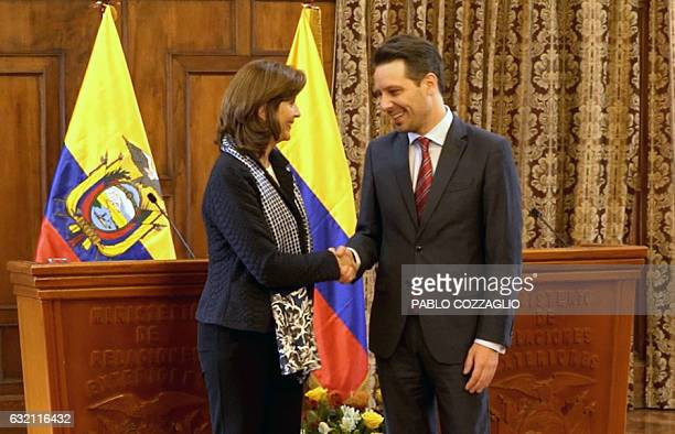 Colombian Foreign Minister Maria Angela Holguin and her Ecuadorean counterpart Guillaume Long shake hands at the end of a press conference in the...