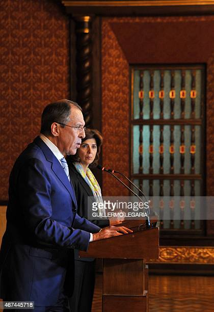 Colombian Foreign Minister Maria Angela Holguin listens to her Russian counterpart Sergei Lavrov during a joint press conference after a meeting at...