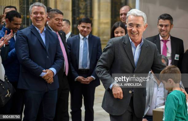 Colombian former president and current senator Alvaro Uribe and presidential candidate Ivan Duque who is planning to run for Uribe's Centro...