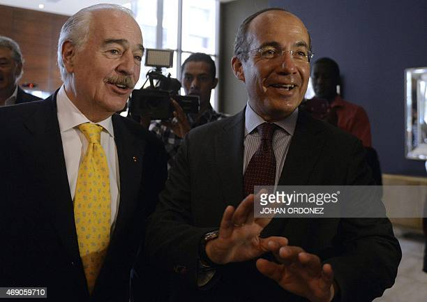 Colombian former President Andres Pastrana speaks with Mexican former President Felipe Calderon before a press conference about the situation of...