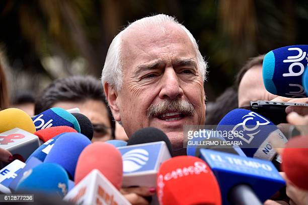 Colombian former president Andres Pastrana talks to the press after holding a meeting with Colombian President Juan Manuel Santos at Narino Palace in...