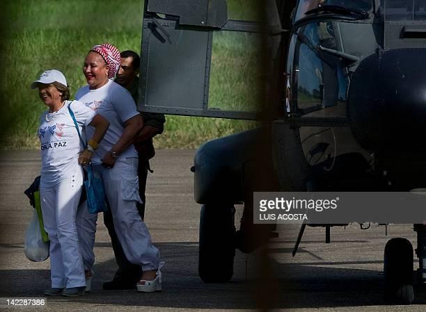 Colombian former senator Piedad Cordoba arrives on a Brazilian helicopter at Vanguardia airport in Villavicencio, Colombia, on April 1, 2012....