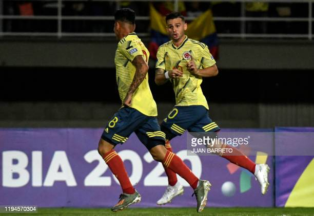 Colombian forward Jorge Carrascal celebrates with midfielder Nicolas Benedetti after scoring against Argentina during their Under23 South American...