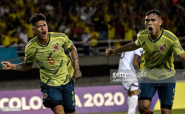 Colombian forward Jorge Carrascal celebrates with teammate forward Ricardo Marquez after scoring against Venezuela during their Under23 South...