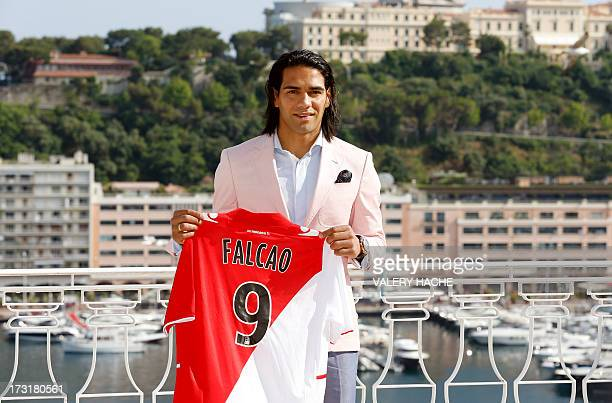 Colombian forward Radamel Falcao poses while holding his new jersey from French L1 Monaco football club after a press conference on July 9 2013 in...