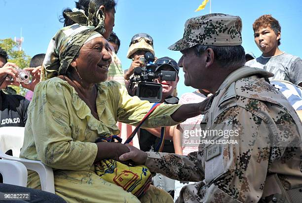 Colombian General Commander of the Military Forces Freddy Padilla greets a Colombian Wayuu indigenous woman during a meeting between the army and...