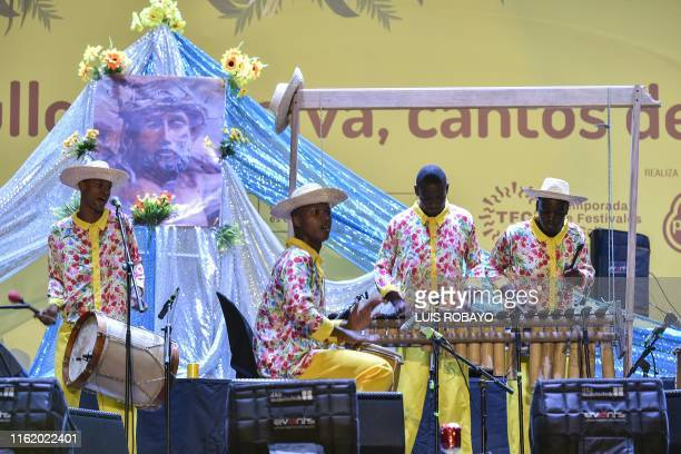 Colombian group Lumbalu performs onstage at the 23rd Petronio Alvarez Pacific Music Festival in Cali Colombia on August 16 2019 The Petronio Alvarez...