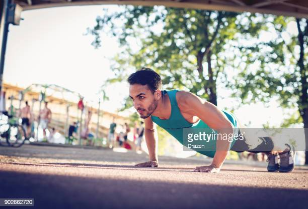 Colombian guy doing push ups outdoors