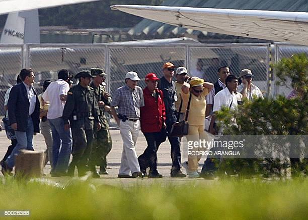 Colombian High Comissioner Luis Carlos Restrepo , Venezuelan Interior minister Rodriguez Chacin and Colombian senator Piedad Cordoba walk at Jorge...