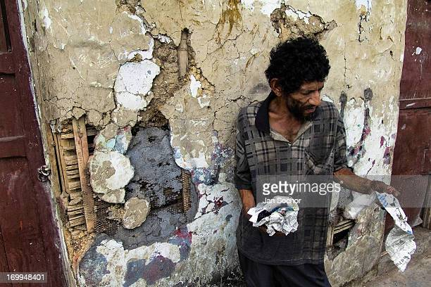 Colombian homeless man stands on the street in the slum of Calvario on 5 April 2004 in Cali, Colombia. Calvario, a slum right in the centre of the...