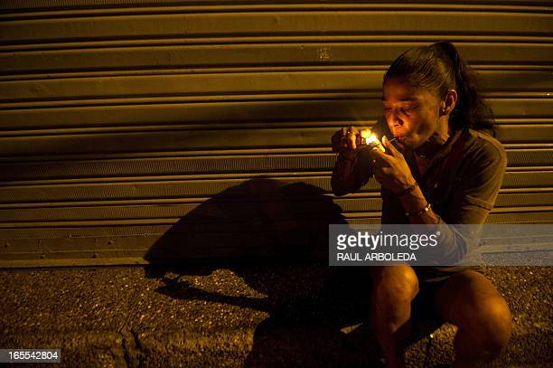 A Colombian homeless woman smokes crack in the Barrio Triste neighborhood in Medellin Antioquia department Colombia on April 3 2013 Medellin Mayor's...