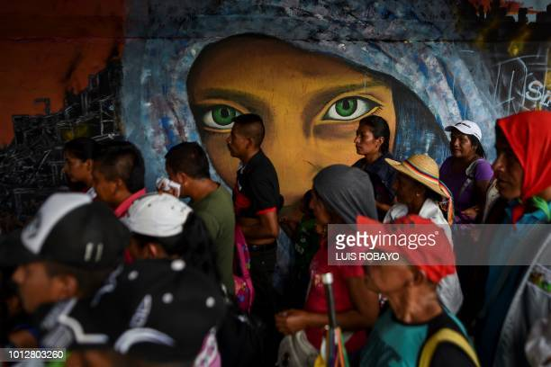 Colombian indigenous people demonstrate against Colombia's Presidentelect Ivan Duque on the day of his inauguration in Cali Colombia on August 7 2018...