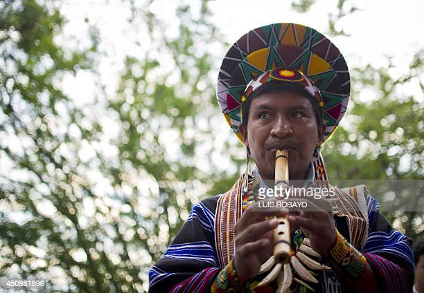 Colombian indigenous people from the Quechua ethnic group participate in a ritual during the celebration of the Inti Raymi on June 21 2014 in Cali...