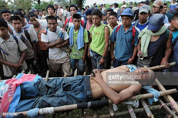 Colombian indigenous people stare at the dead body of mate Jesus Antonio Nene on October 21 2008 in Villarrica Valle del Cauca department Colombia...