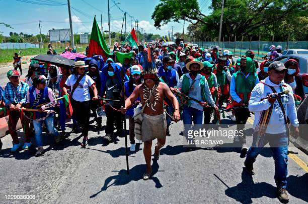 """Colombian indigenous people taking part in a """"Minga"""" walk along the Pan-American highway as they arrive in the city of Cali with the expectation of..."""