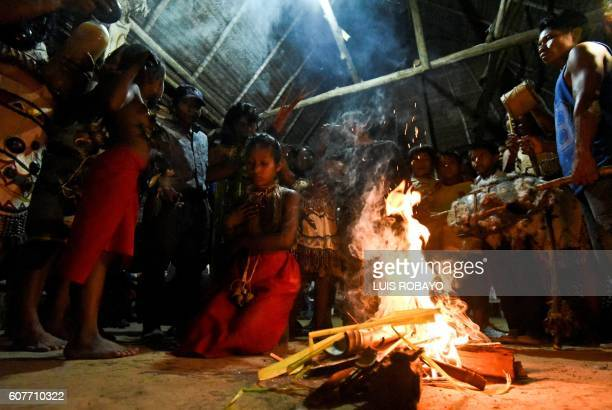 Colombian indigenous women of the Tikuna ethnic group take part in a ritual at the start of the 'First Intergenerational Summit on Traditional...