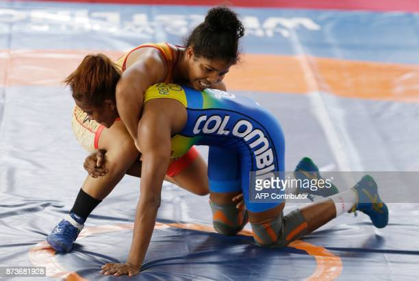 Colombian Jackeline Renter wrestles with Nathaly Briman of Venezuela during the final of the women's GrecoRoman 63kg wrestling event of the XVIII...