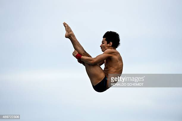 Colombian Juan Rios competes in the final of the men's 10 m platform diving competition during the XXII Central American and Caribbean Games in Boca...