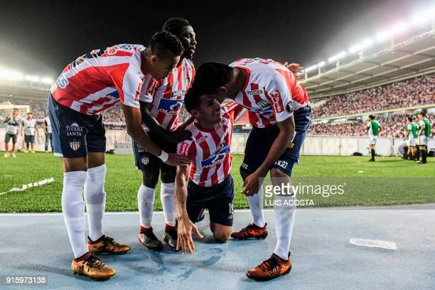 Colombian Junior forward Teofilo Gutierrez celebrates with his teammates after scoring against Paraguay's Olimpia during their Copa Libertadores...
