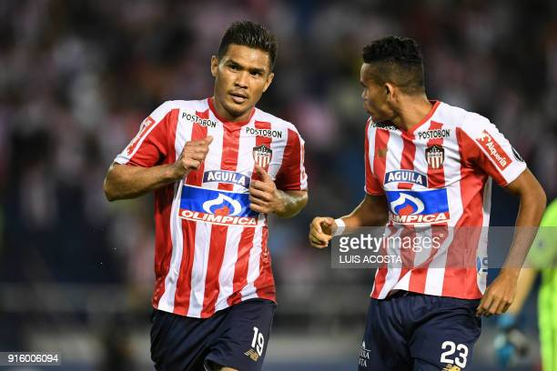 Colombian Junior forward Teofilo Gutierrez celebrates with his teammate midfielder Luis Diaz after scoring against Paraguay's Olimpia during Copa...