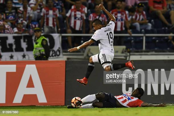 Colombian Junior forward Yimmi Chara vies for the ball with Paraguayan Olimpia defender Colombian Farid Diaz during Copa Libertadores football match...