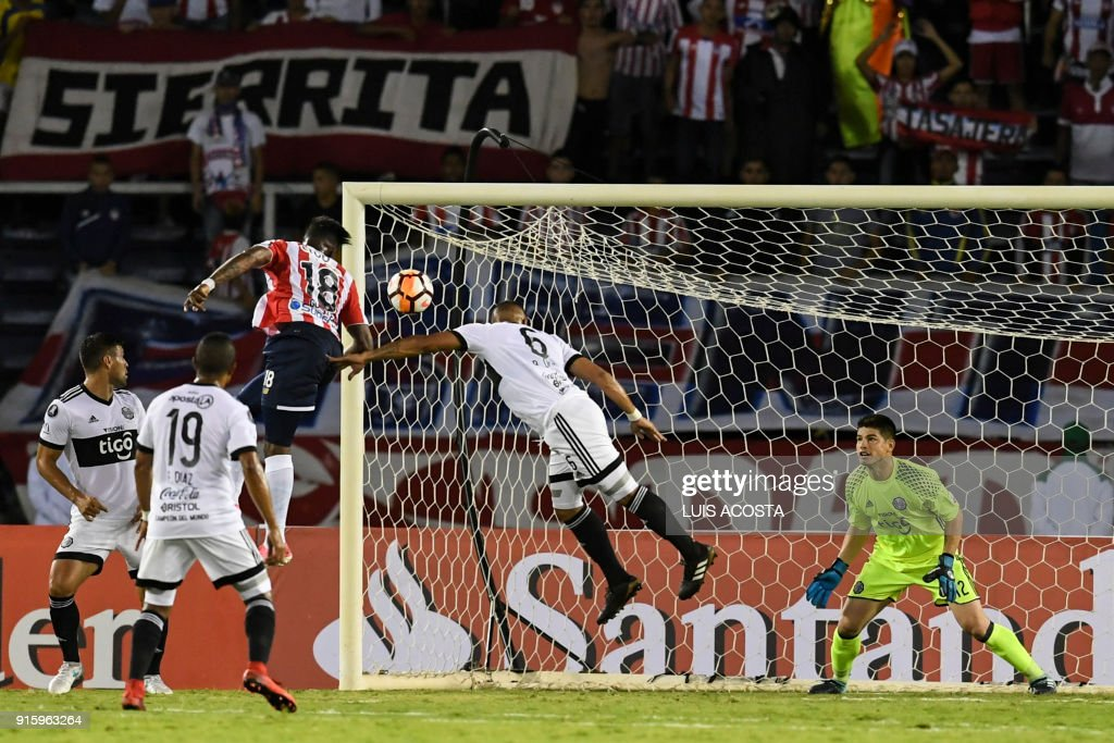 Colombian Junior midfielder Yony Gonzalez (C-L) scores a goal against Paraguay's Olimpia during their Copa Libertadores football match at Roberto Melendez stadium in Barranquilla, Colombia, on February 8, 2018. / AFP PHOTO / Luis ACOSTA