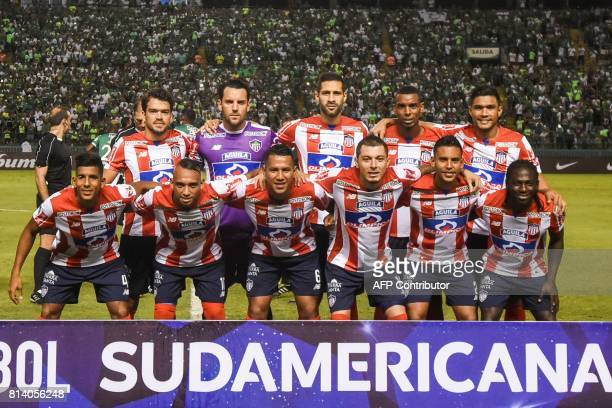 Colombian Junior team members pose for a picture before the start of their Copa Sudamericana football match against Colombian Deportivo Cali at the...