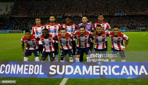 Colombian Junior team players pose for the picture before the start their Copa Sudamericana quarterfinals second leg football match against Brazilian...