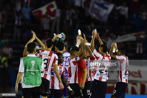 Colombian Junior team players wave to their supporters at the end Copa Sudamericana quarterfinals second leg football match against Brazilian Sport...