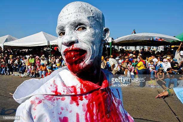 A Colombian man wearing a vampire mask with bloody teeth dances during the Carnival in Barranquilla Colombia 25 February 2006 The Carnival of...