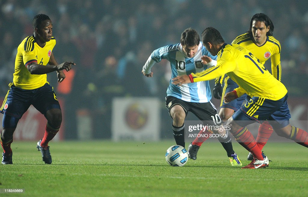 Colombian midfielder Carlos Sanchez (L), forward Radamel Falcao (R) and midfielder Freddy Guarin mark Argentine forward Lionel Messi (C) during a 2011 Copa America Group A first round football match held at the Cementerio de Elefantes stadium in Santa Fe, 476 Km north of Buenos Aires, on July 6, 2011.