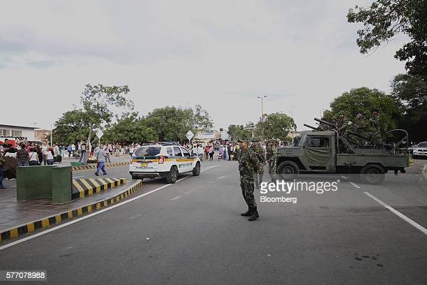 Colombian military police officers stand guard as Venezuelans cross into Cucuta Colombia on Sunday July 17 2016 For only the third time in a year...