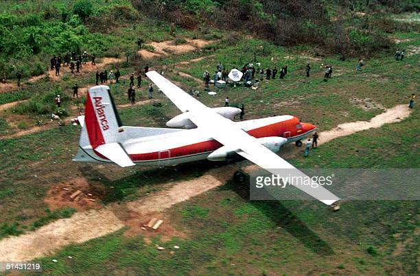 Colombian military secures 13 April 1999 the area around the hijacked Colombian Avianca airline Fokker50 plane abandoned by its hijackers at a small...