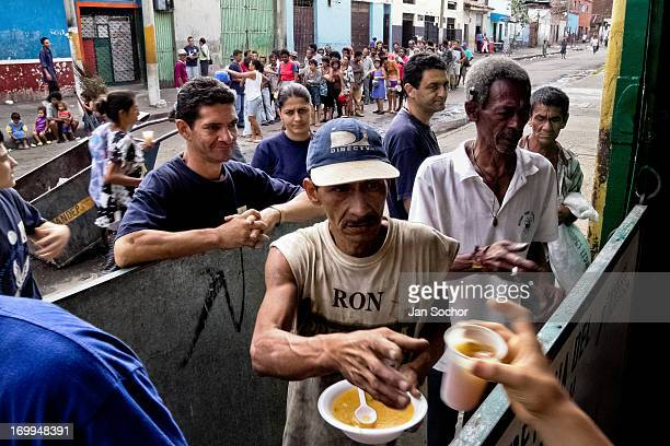 Colombian missionary organization distributes food in the slum of Calvario on 20 April 2004 in Cali Colombia Calvario a slum right in the centre of...