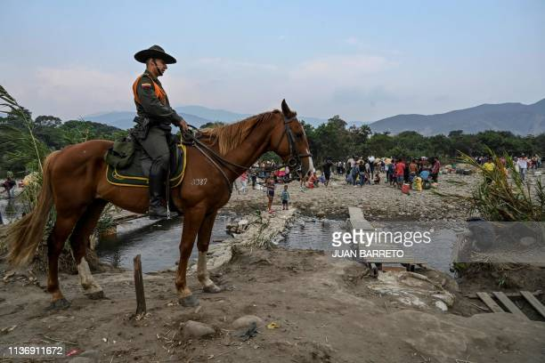 Colombian mounted police officer stands guard along the trochas illegal trails on the border between Cucuta in Colombia and San Antonio del Tachira...