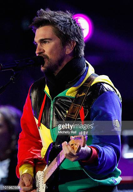 Colombian musician Juanes performs on stage during the FIFA World Cup Kick-off Celebration Concert at the Orlando Stadium on June 10, 2010 in...