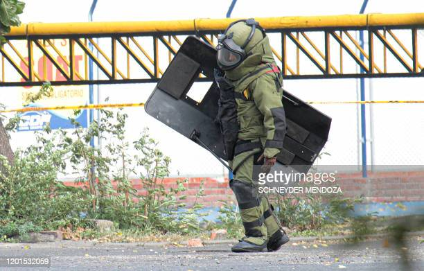 Colombian national police bomb squad member prepares to detonate an explosive device in the border city of Cucuta located northeast of Bogota, on...