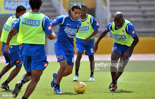 Colombian national team footballer Falcao Garcia vies for the ball with teammates during a training session at Pascual Guerrero Stadium on March 27...