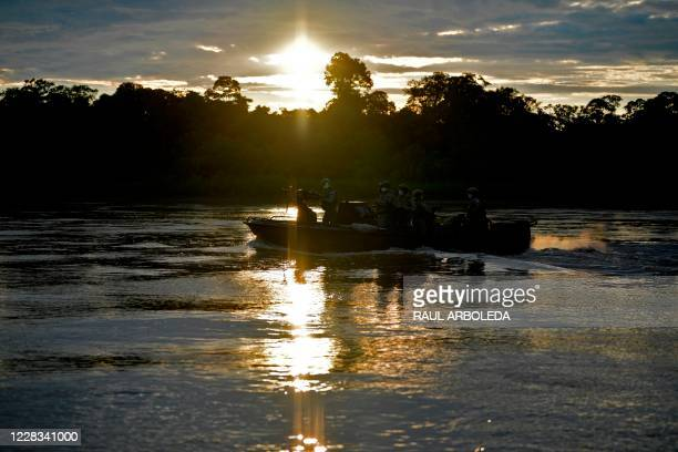 Colombian Navy members patrol the Guayabero river in Guaviare department, Colombia on September 2, 2020.