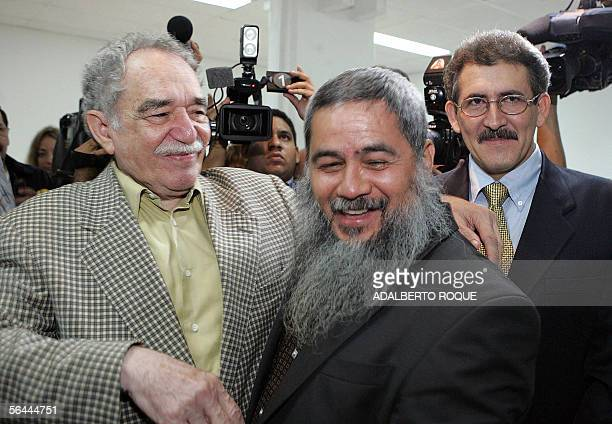 Colombian Nobel laureate in literature Gabriel Garcia Marquez greets the leader of the guerrilla group National Liberation Army Francisco Galan and...