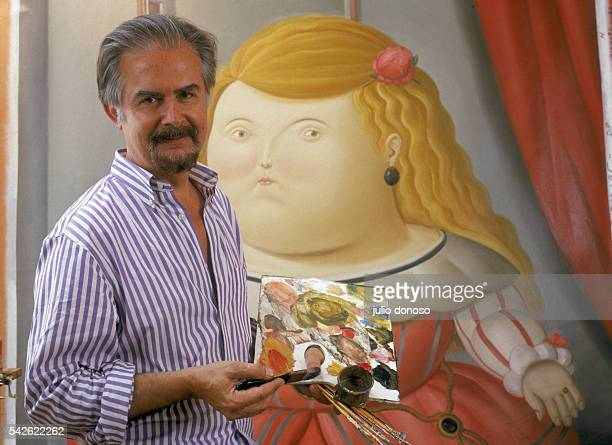 Colombian painter and sculptor Fernando Botero poses with one of his paintings in his Paris studio Born in Medellin Colombia in 1932 Botero is known...
