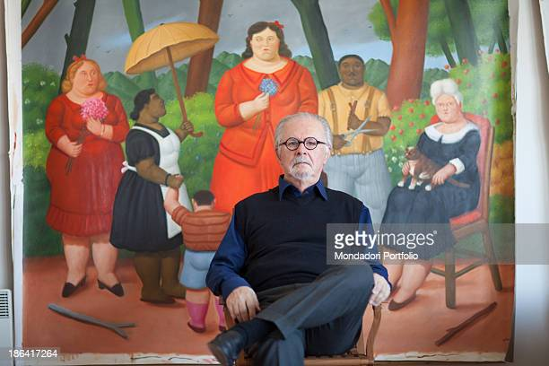 Colombian painter and sculptor Fernando Botero sitting in his studio in front of a painting depicting a group in a garden Monte Carlo 15th March 2012