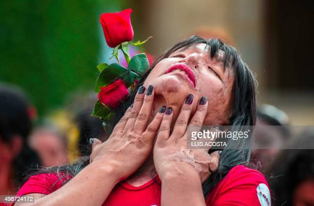 Colombian Patricia Espitia victim of an attack with acid performs during the International Day for the Elimination of Violence against Women in...