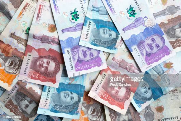 colombian peso bills of different values close up.  colombian money, paper money, cash. concept of abundance and prosperity - dinero fotografías e imágenes de stock