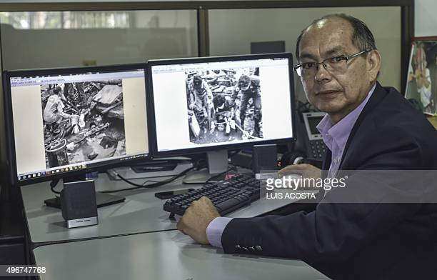 Colombian photojournalist Jairo Higuera speaks during an interview with AFP in Bogota on November 9 2015 about the tragedy of Armero a village...