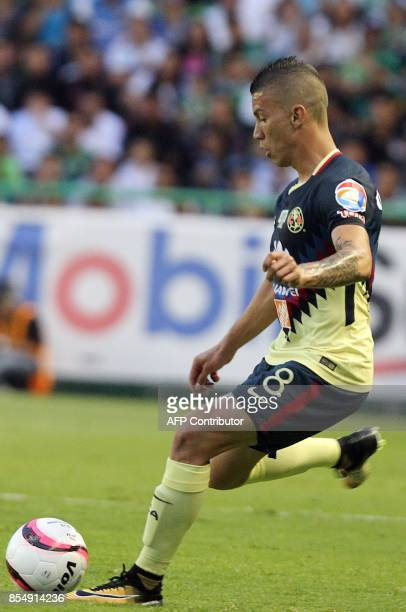 Colombian player Andres Uribe of America vies for the ball during their match against Leon during their Mexican Apertura tournament football match at...