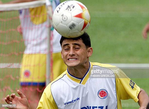 Colombian player Giovanni Hernandez of national soccer team heads the ball during a practice session in Armenia Colombia 28 July 2001 Colombia is...