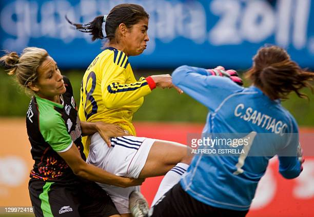 Colombian player Katerin Castro is marked by Mexican player Jennifer Ruiz and goalkeeper Cecilia Santiago during a women's first round football match...